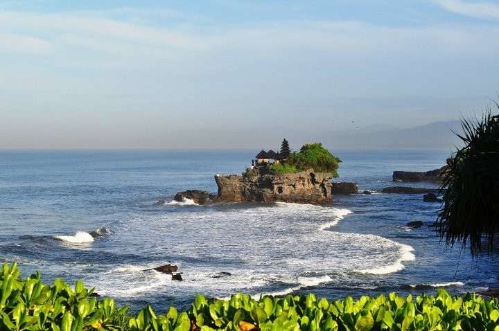 The Tanah Lot Temple at high tide when it becomes an island.