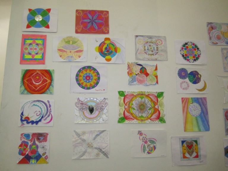 When we had finished, all the mandalas were put on the wall of our Conference Room.