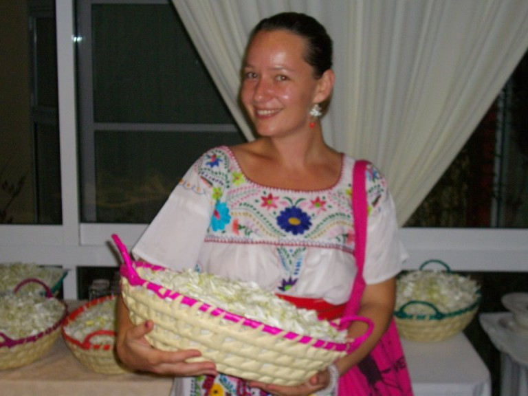 Petra holds one of our flower baskets.