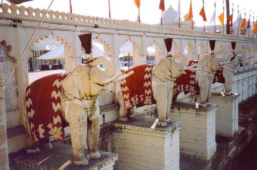 Eight stone elephants are Guardians of the palace walls.