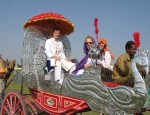 Karon, Mary and Ti-Mon-Ra ride in a silver cart.