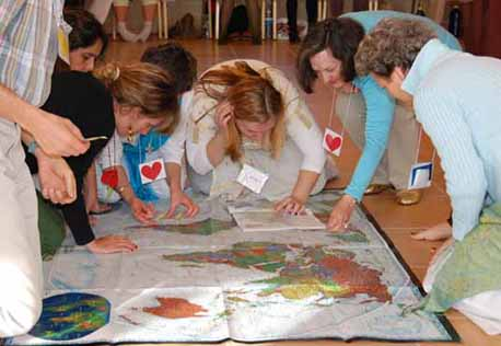 Putting stickers on our Anchor Map in Brazil, Slovenia and Austria.