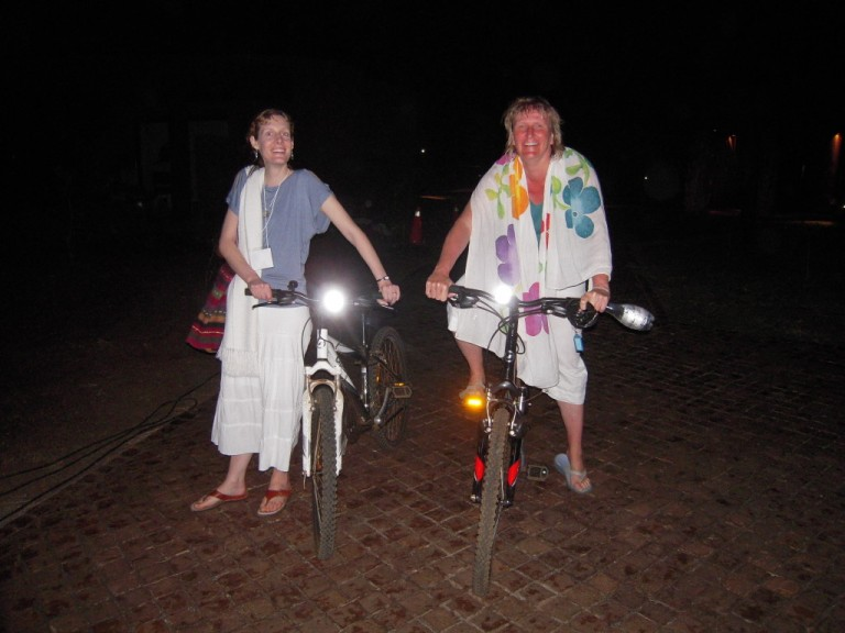 Alanah and Laya rode bicycles to their nightly swim in the ocean.
