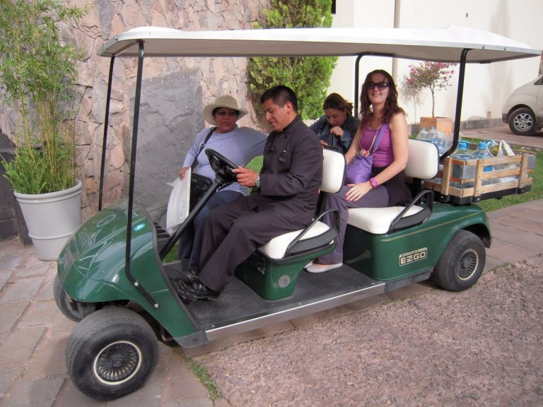 Anastra from Australia, Adriana from Slovakia and Maria from New Zealand catch a ride in the golf cart.