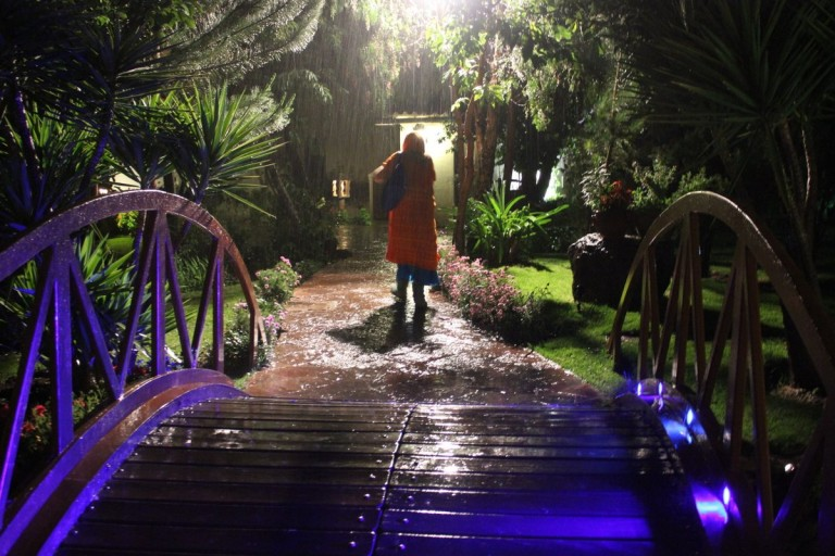 Indigo heads back to her room in the pouring rain.