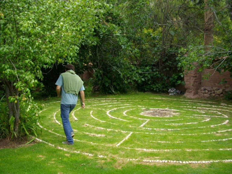 Felipe enters the hidden labyrinth in the back garden.