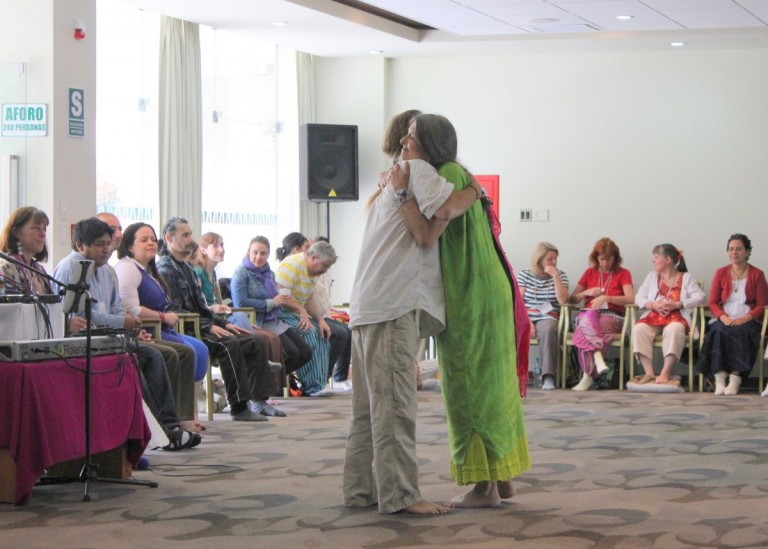 Solara embracing Omashar before a session.